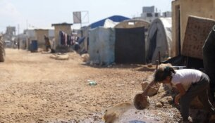 This Sunday, April 19, 2020, photo, shows a large refugee camp on the Syrian side of the border with Turkey, near the town of Atma, in Idlib province, Syria. The rapid spread of the coronavirus has raised fears about the world's refugees and internally displaced people, many of whom live in poor or war-ravaged countries that are ill-equipped to test for the virus or contain a possible outbreak. (AP Photo/Ghaith Alsayed)